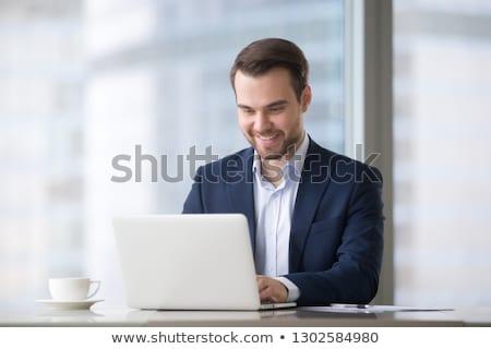 empresario · tecnología · jóvenes · negocios · nubes - foto stock © hasloo