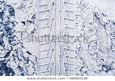 Tire Tread In Snow And Ice Stock photo © searagen