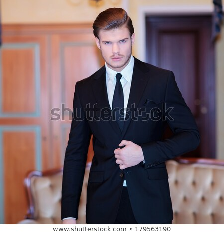 handsome business man unbuttoning his jacket  Stock photo © feedough