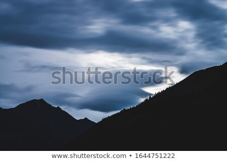 A lenticular cloud above alpine peaks Stock photo © chrisga