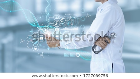 Woman doctor holding futuristic tablet computer Stock photo © HASLOO