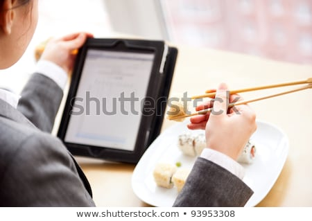 Stock photo: Pretty Woman Browsing at her Tablet Computer