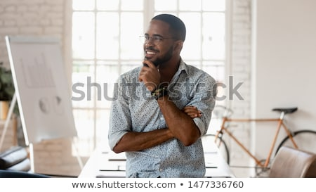 Thoughtful Businessman Standing With Hand On Chin Stock photo © AndreyPopov