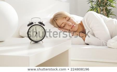 menina · cama · mulher · amor · feliz · relógio - foto stock © deandrobot