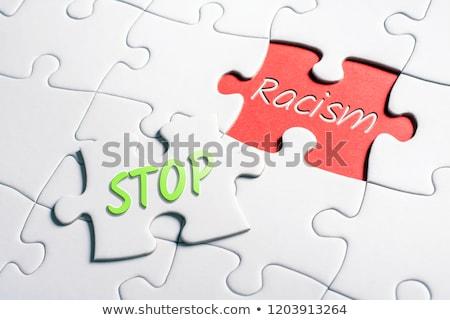 racism   white word on red puzzles stock photo © tashatuvango