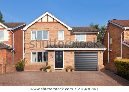 Traditional brick house with garage. Stock photo © iriana88w