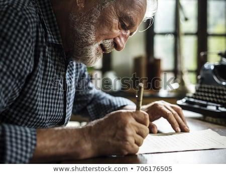 homem · escrever · retrato · moço · escrita · vidro - foto stock © tiero