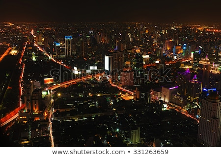 Brightly Lit, Nightime Skyline of a City in Asia Stock photo © pzaxe