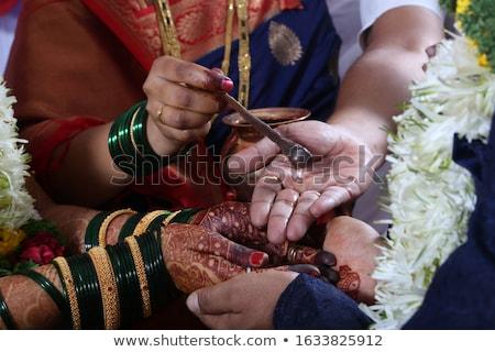 Indian groom doing marriage rituals. Stock photo © ziprashantzi