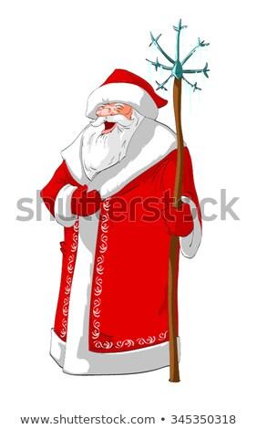 Russian Santa Claus feeds the bird titmouse Stock photo © orensila