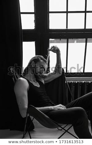 Sexy брюнетка женщину кровать модный Сток-фото © oleanderstudio