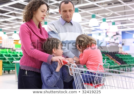 elderly man and  young woman with children in shop with empty sh Stock photo © Paha_L