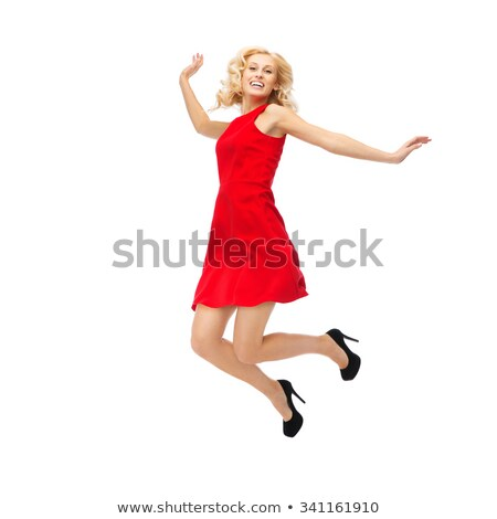 happy young woman in red dress jumping high Stock photo © dolgachov