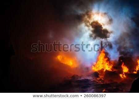 Tűz köteg autógumik város füst zászló Stock fotó © jossdiim