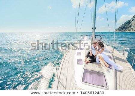 Giovani bella rilassante yacht insieme Foto d'archivio © deandrobot