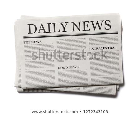 Journal roulé up blanche papier Photo stock © goir