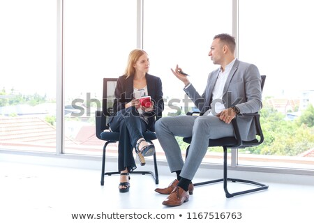 Young businesswoman or office worker with two cups coffee and smartphone in hands. Socializing Conce stock photo © teirin_toys