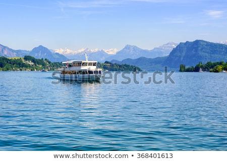 Navio de cruzeiro lago alpes montanhas Suíça verde Foto stock © Xantana