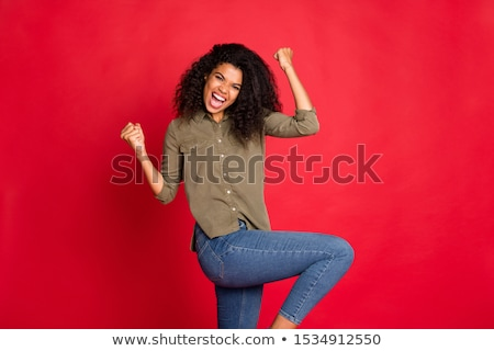 Beautiful girl in red sport body on red background Stock photo © DenisMArt