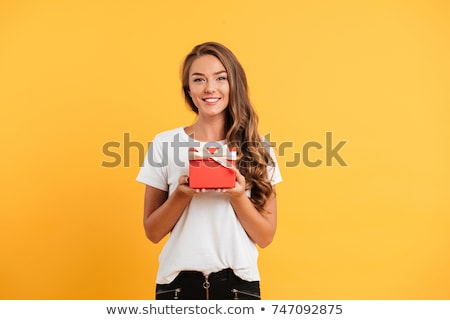portrait of happy woman holding gift in hand and looking to camera on black, international womens da Stock photo © LightFieldStudios