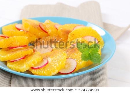 Dilimleri turuncu turp tarçın turkuaz plaka Stok fotoğraf © Digifoodstock