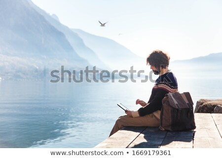 Business man sitting by shoreline Stock photo © IS2