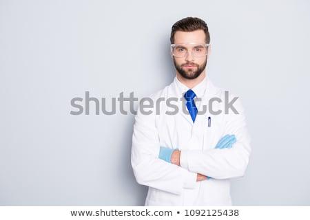 Arts wetenschapper laboratoriumjas medische handschoenen geneeskunde Stockfoto © dolgachov