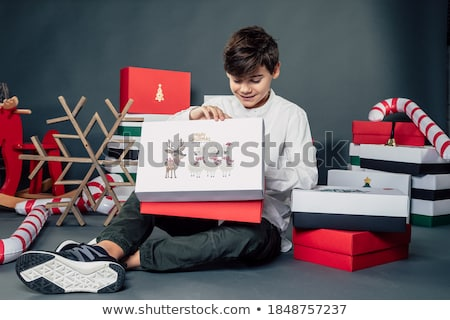 boy looking at box tower stock photo © is2