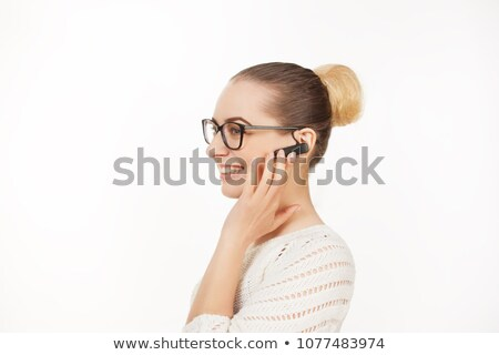 Business woman using bluetooth headset Stock photo © IS2