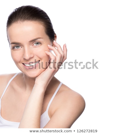 closeup shot of young beauty woman massaging her face facial massage concept isolated on white bac stock photo © nobilior