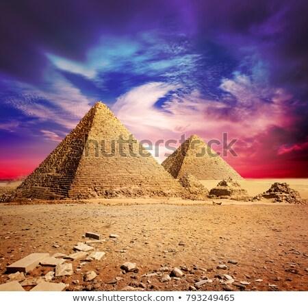 Pirâmides violeta nuvens deserto sol pôr do sol Foto stock © Givaga