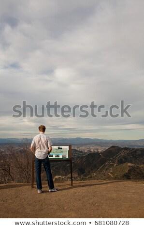 Férfi olvas információ jel Kalifornia USA hegy Stock fotó © IS2