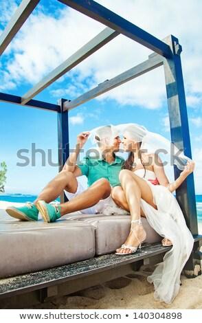 Güneş öpüşme plaj yaz kadın Stok fotoğraf © IS2