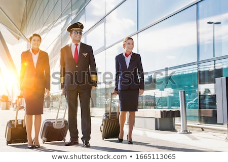 Pilot and flight attendant Stock photo © IS2