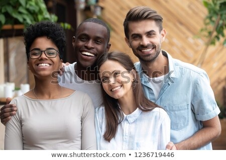 Group of excited young multiethnic friends Stock photo © deandrobot