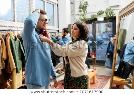 couple choosing clothes at vintage clothing store stock photo © dolgachov