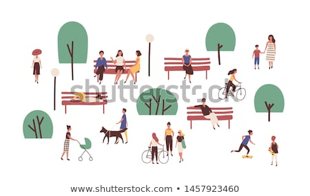 people in park couple walks together skateboard stock photo © robuart