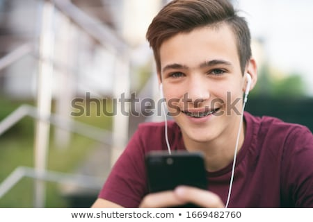 smiling young teenage boy spending time stock photo © deandrobot