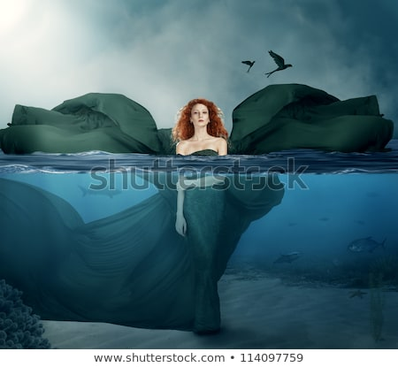 Young woman in the sea with red starfishes stock photo © galitskaya
