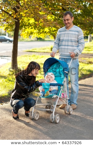 Autumn Park and Couple Walking with Baby Carriage Stock photo © robuart