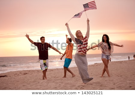 friends at american independence day beach party Stock photo © dolgachov