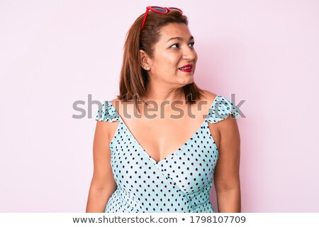 Side view of Smiling brunette woman in dress and sunglasses Stock photo © deandrobot