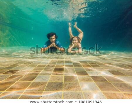 Férfi nő fenék medence alámerülés víz Stock fotó © galitskaya