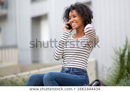 glimlachend · jonge · vrouw · praten · mobiele · telefoon · naar · afbeelding - stockfoto © deandrobot
