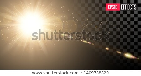 Golden Shining Sun With Transparent Rays And Lenses Refraction Gold Detonation Effect Foto stock © Tashatuvango