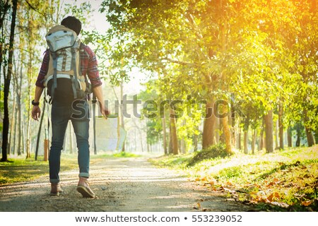 young man traveler with backpack handle map relaxing outdoor on stock photo © freedomz