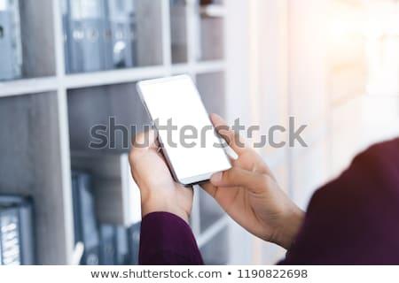 mockup image of man hand holding white smart phone with blank sc stock photo © freedomz
