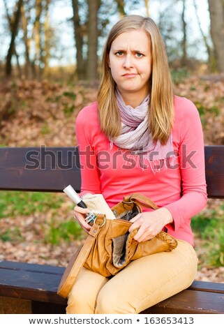Angry young woman pursing her lips Stock photo © Giulio_Fornasar