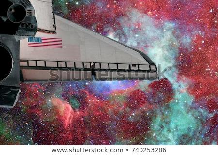 Stock photo: Space Shuttle flight over space nebula.