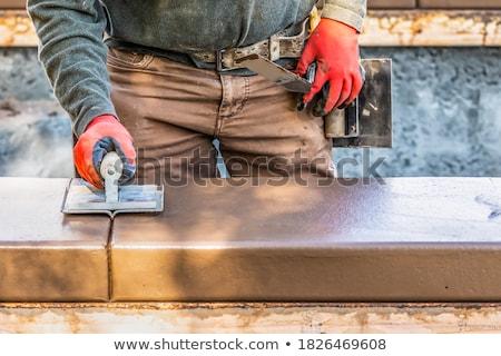 építőmunkás kéz nedves cement zsaru körül Stock fotó © feverpitch